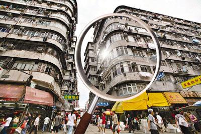 香港有相应的楼盘强制检修制度,但是政府提供了很多支援措施